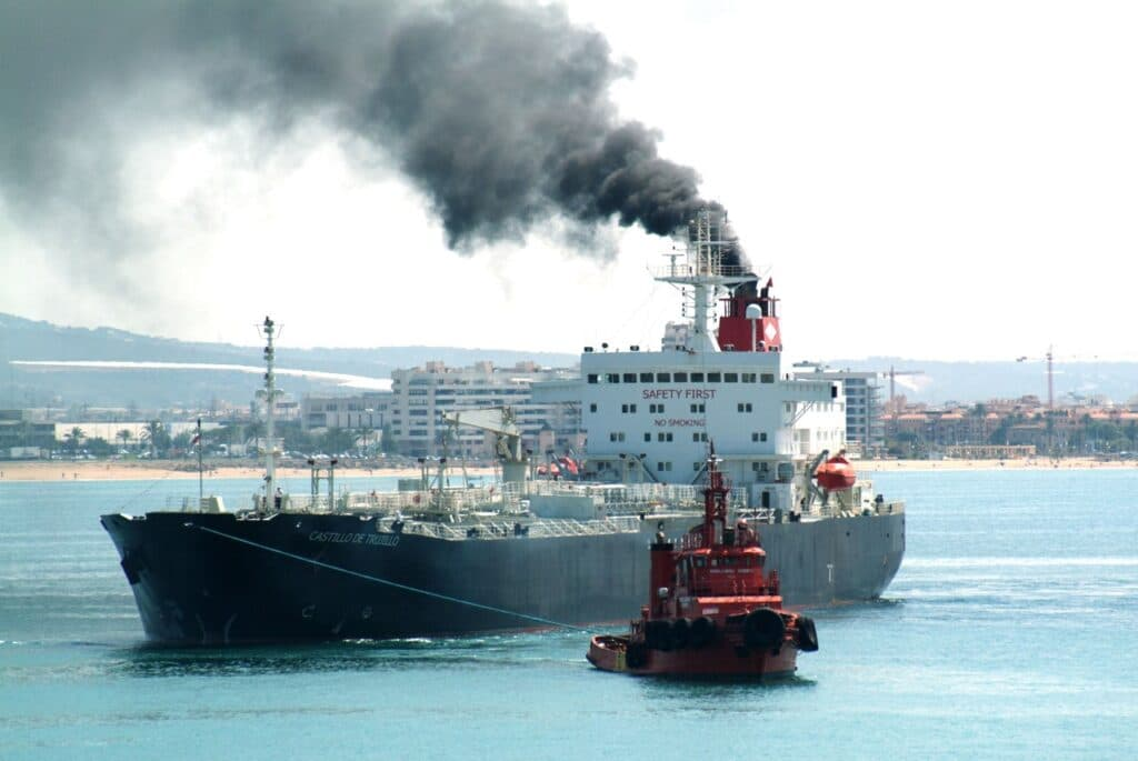 Black smoke emitted by funnel of a ship